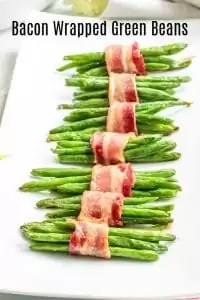 These Bacon Wrapped Green Bean Bundles with brown sugar are baked in the oven for perfectly roasted green beans wrapped in crispy bacon and coated in a delicious brown sugar glaze. It's an easy recipe that makes a great EAster side dish, Thanksgiving side dish, or Christmas side dish. #easter #thanksgiving #christmas #sidedish #greenbeans #bacon #homemadeinterest