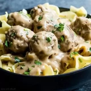Egg Noodles topped with Easy swedish meatballs and sauce.