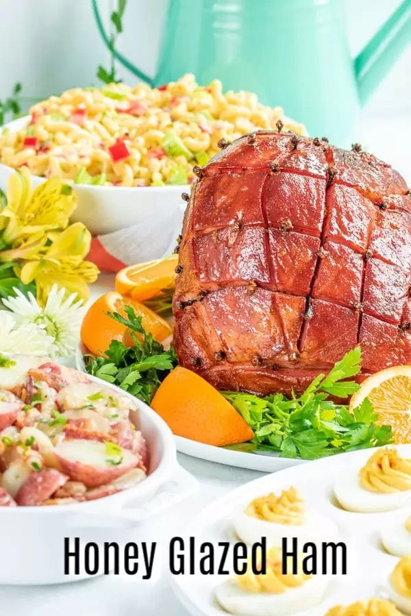 Honey Glazed Ham is an easy recipe for baked ham with a glaze made form honey, brown sugar, ginger, and orange zest. Bake your spiral ham or whole fully-cooked ham, bone-in or boneless in the oven with this delicious sweet glaze. It's the best honey glazed ham recipe you can make for Easter dinner or Christmas dinner! #ham #honey #Easter #Christmas #easydinnerrecipes #homemadeinterest