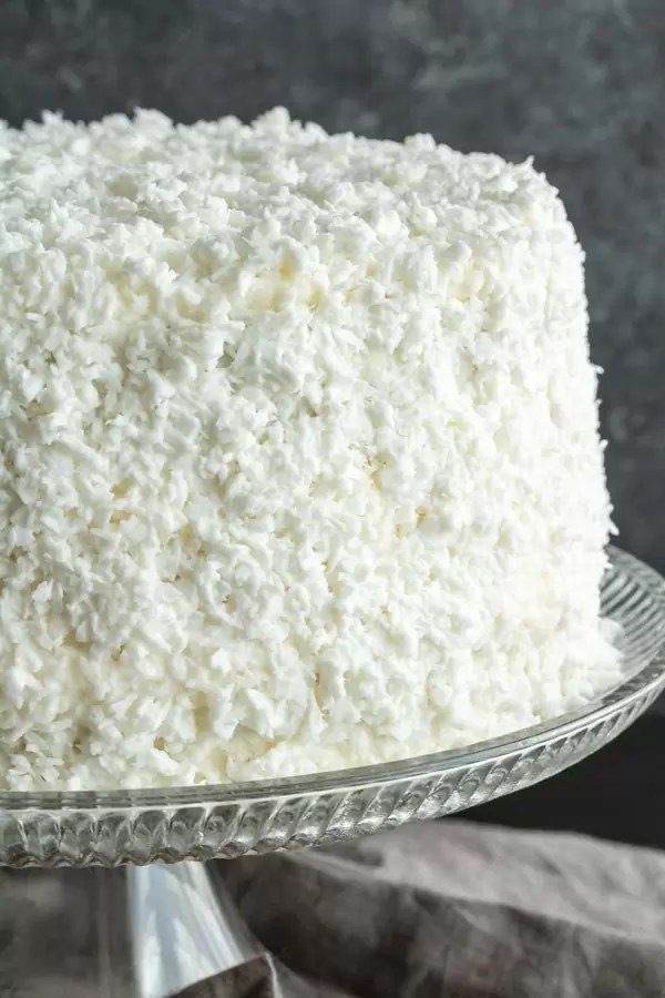 A beautiful coconut cake with fresh coconut on the outside