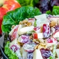 This traditional Waldorf Salad recipe is made with a mayonnaise dressing, crisp apples, celery, grapes, and walnuts. It's a classic side dish that makes a great Easter side dish, Mother's Day side dish, or Thanksgiving side dish. Substitute yogurt for mayonnaise and add chicken to make a healthy lunch. #salad #grapes #apples #walnuts #Easter #Motherday #Thanksgiving #homemadeinterest
