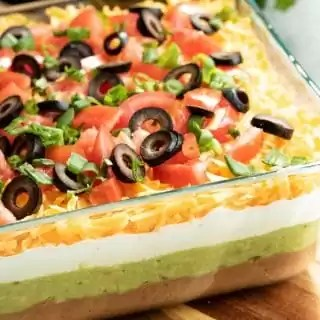 7 Layer Dip layered with beans, guacamole and sour cream