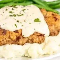 Chicken Fried Steak on top of mash potatoes