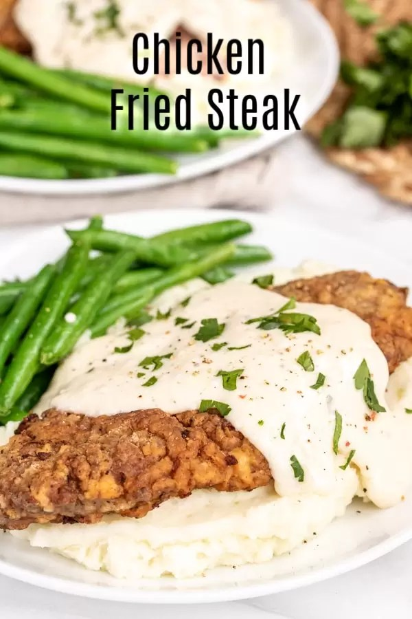 This easy recipe for Southern Chicken Fried Steak is made with tender cube steak, and spicy breading that is friend until perfectly crispy. The chicken fried steak is topped with a homemade white gravy that you'll want to sop up with a biscuit! This is the BEST Chicken Fried Steak recipe, even better than Cracker Barrel! ;) #steak #beef #southernrecipes #comfort food #gravy #homemadeinterest