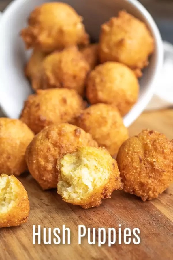 This homemade Southern Hush Puppies recipe is made with cornmeal and onions that are fried until perfectly crispy. It's an easy southern recipe that is a classic side dish for a fish fry, or fried shrimp. It's the BEST hush puppies recipe you'll ever make! #corn #cornbread #hushpuppies #southerrecipe #homemadeinterest