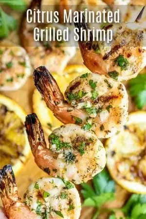 This easy grilled shrimp recipe is marinated in a citrus marinade made with oranges, lemons, limes, garlic, ginger, and fresh herbs. Make healthy, low carb, shrimp kabobs for an easy grilled dinner on a busy weeknight. Simple Citrus Marinated Grilled Shrimp is the best grilled shrimp recipe for summer and Cinco de Mayo! #grilled #grilling #shrimp #marinade #cincodemayo #homemadeinterest