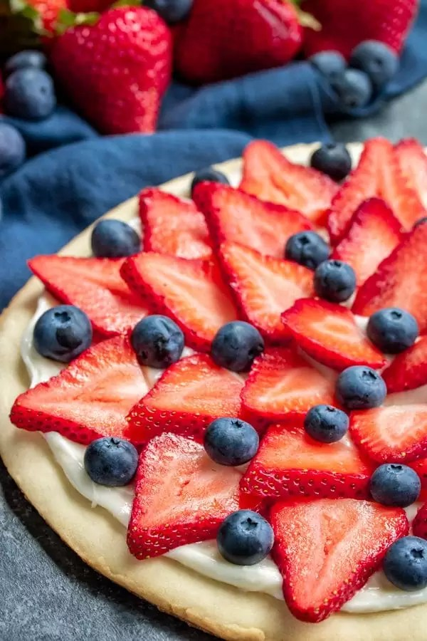 layered strawberries and blueberries make a Red, White & Blue Fruit Pizza