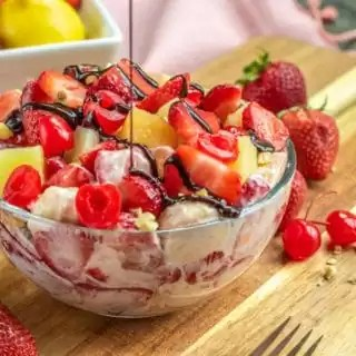 Banana Split Cheesecake Salad with a drizzle of chocolate sauce