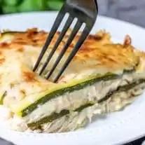 Fork going in for a bite of Chicken Alfredo Zucchini Lasagna