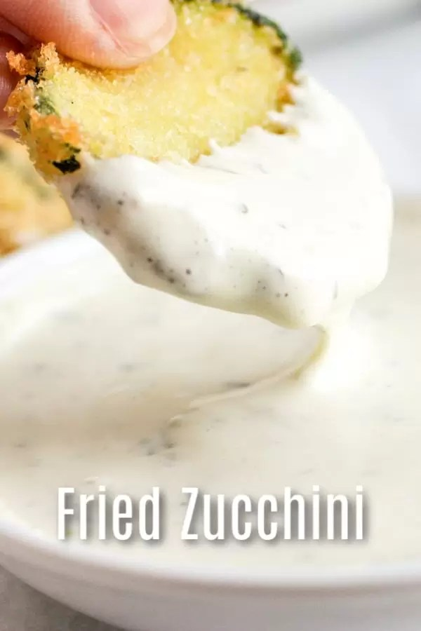This recipe for Crispy Fried Zucchini is deep fried in a skillet for crisp zucchini chips made with panko bread crumbs, batter, and served with a lemon aioli dipping sauce. It's an easy and delicious zucchini recipe that makes a great appetizer. #zucchini #fried #panko #appetizer #homemadeinterest