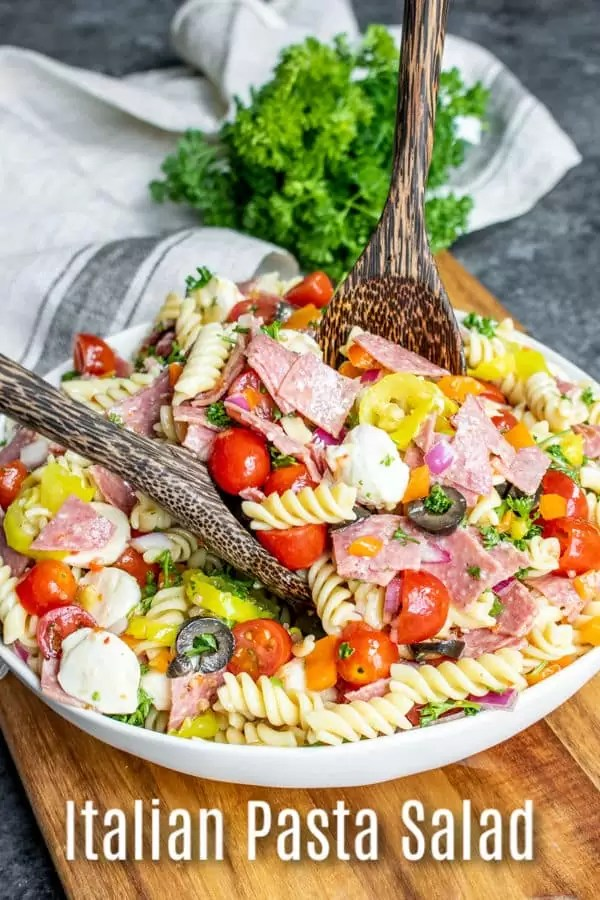 This easy Italian Pasta Salad is a classic cold pasta salad recipe made with pasta, salami, Italian vegetables, mozzarella cheese, and a zest Italian dressing. It is one of the BEST traditional pasta salad recipes for a crowd. Make this Italian pasta salad for your next pot luck and watch it disappear! #italian #pasta #pastasalad #salami #potluck #homemadeinterest