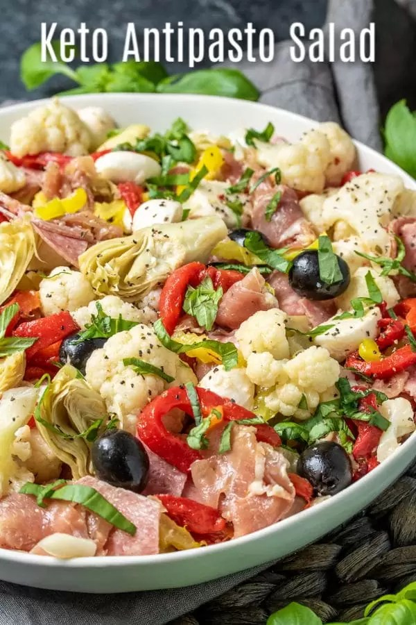 This easy keto antipasto salad is a low carb side dish that is packed full of Italian flavor. This healthy antipasto recipe is made with cauliflower, salami, prosciutto, Italian vegetables, and homemade dressing for a delicious appetizer or side dish that is perfect for a crowd. #homemadeinterest #ketodiet #ketorecipes #lowcarb #lowcarbdiet #antipasto #Italian #cauliflower