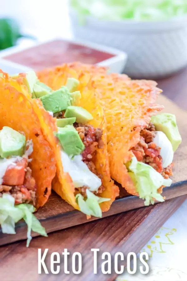 Have a low carb taco night with these keto tacos made with cheese taco shells. Baked cheddar cheese formed into the shape of a taco! These easy keto tacos are beef tacos that are perfect for people who are looking for keto diet recipes for a ketogenic lifestyle. These cheesy low carb tacos mean you don't have to miss out on taco night! #taco #cheese #lowcarb #keto #ketorecipes #lowcarbdinner #homemadeinterest
