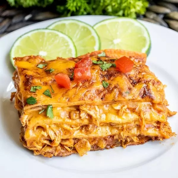 piece of Chicken Enchilada Casserole on a plate