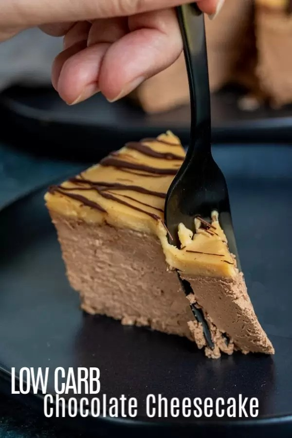 This Low Carb Chocolate Cheesecake is a luscious, creamy, chocolate cheesecake recipe topped with a creamy keto peanut butter mousse. It's one of the best low carb dessert recipes you'll ever make. Dark chocolate cheesecake and peanut butter mousse are the perfect combination. They will satisfy your keto dessert cravings! #dessert #chocolate #cheesecake #ketodessert #keto #lowcarb #ketodiet #homemadeinterest