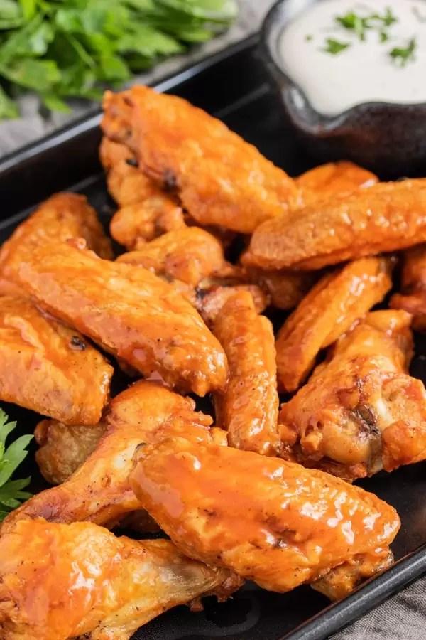 platter of Air Fryer Chicken Wings tossed in buffalo sauce