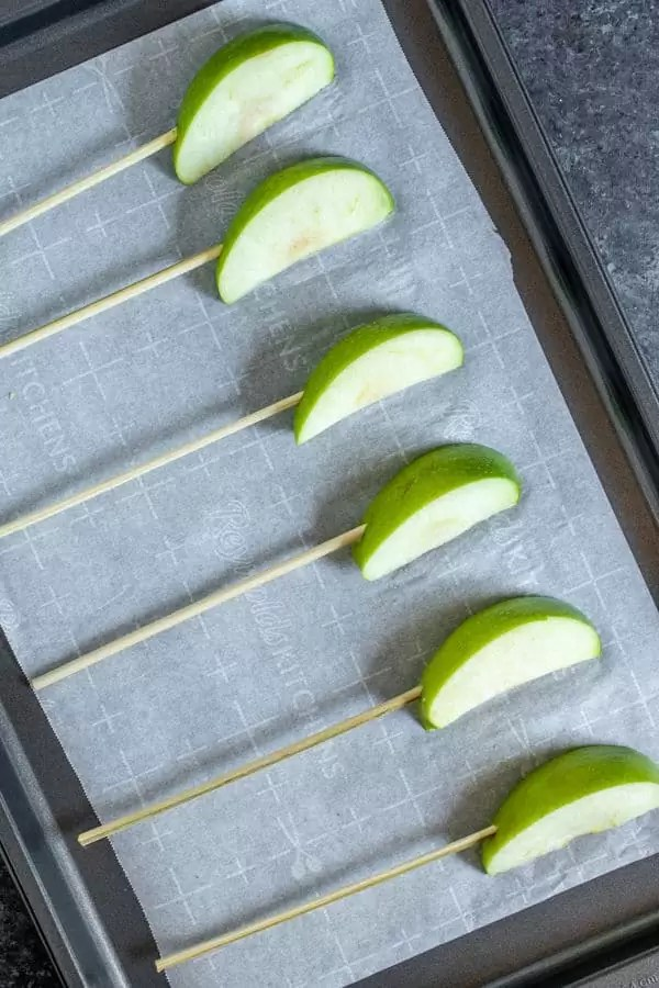 slices of apples on a kabob stick to make Chocolate Covered Apple Kabobs