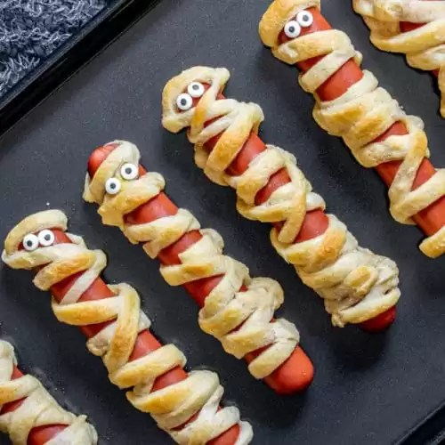 Mummy Dogs Home Made Interest These quick and easy mummy dogs are sure to delight your crowd of hungry goblins!hot dogs and biscuit dough make these tasty treats a snap to whip up. mummy dogs