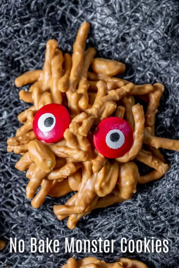 These No Bake Monster Cookies are an easy Halloween dessert made with peanut butter, crunchy chow mein noodles, peanut butter, butterscotch chips, and fun candy eyes. It's an easy no bake haystack cookies recipe with a Halloween twist! Make them for a Halloween party or a fun Halloween treat for the kids. #cookies #nobake #halloween #halloweenparty #dessert