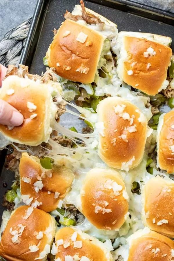 cheesy pan of Philly Cheesesteak Sliders