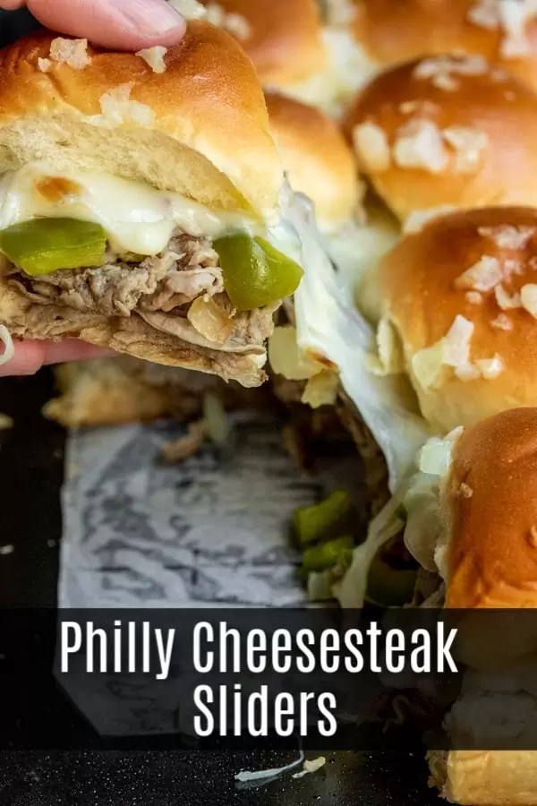 These Philly Cheesesteak sliders are a great football party food idea that is perfect for a crowd. Baked sliders filled with thinly sliced steak, provolone cheese, peppers, and onions make the ultimate Super bowl recipe, March Madness recipe, party appetizer, or just an awesome weeknight dinner recipe. #football #gameday #appetizer #sliders #phillycheesesteak #homemadeinterest