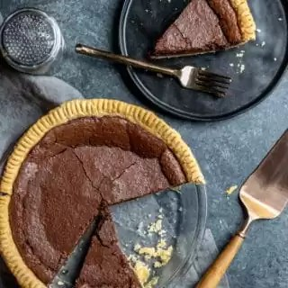whole Chocolate Chess Pie and slice on plate