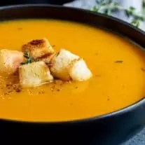 bowl of Instant Pot Butternut Squash Soup topped with croutons