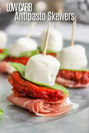These antipasto skewers are an easy keto appetizer to make for parties. They are an elegant, low carb bite size appetizer recipe that is perfect for any brunch, dinner, or an easy New Year's Eve appetizer recipe made with prosciutto, sun dried tomatoes, and fresh mozzarella. #brunch #lowcarb #keto #antipasto #appetizer #proscuitto #mozzarella #cheese #homemadeinterest
