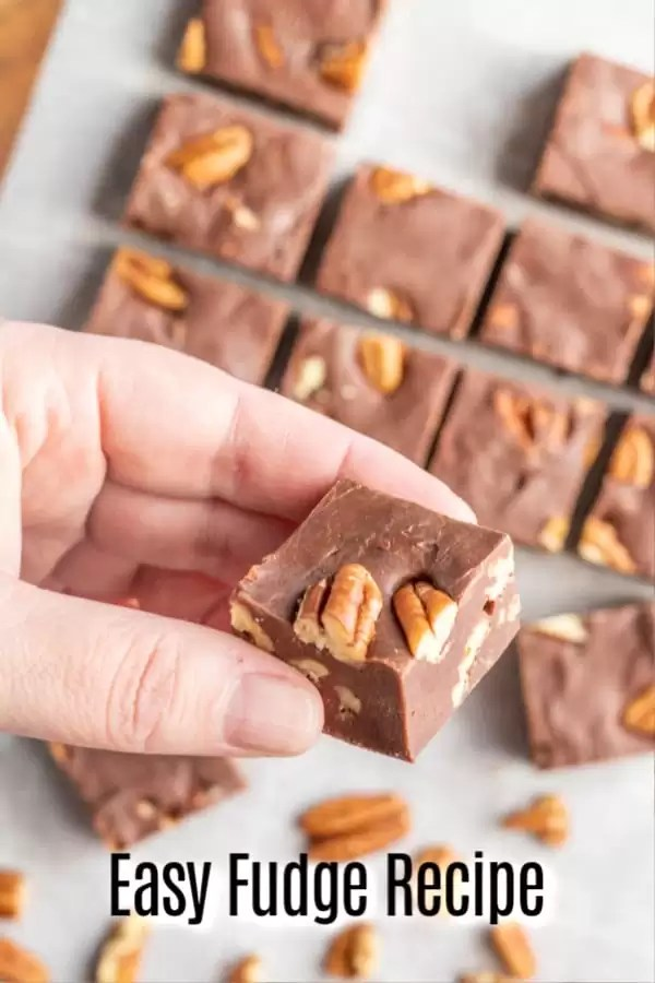 This easy Microwave Fudge recipe is made with 3 ingredients Eagle brand sweetened condensed milk, chocolate, and nuts. It's a delicious homemade candy recipe that makes a great edible gift for all of your homemade gift giving during Christmas. #fudge #chocolate #Christmas #dessert #candy #homemadeinterest