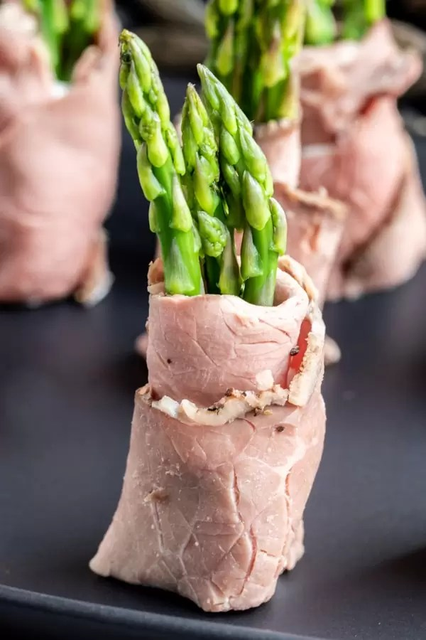 Roast Beef and Asparagus Roll Ups cut in half and sitting upright as a beautiful low carb appetizer