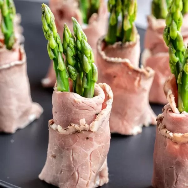 Roast Beef and Asparagus Roll Ups cut in half to make small keto appetizers