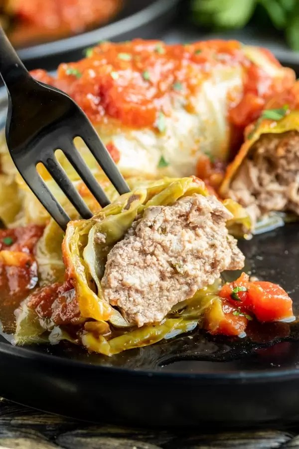 Keto Instant Pot Cabbage Rolls cut open on a fork