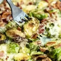 Cheesy Bacon Brussels Sprouts on black fork
