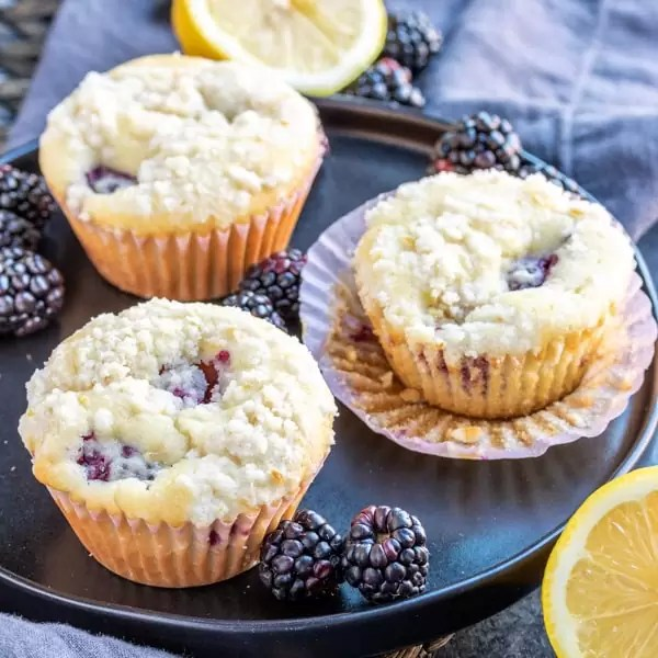 plate with Blackberry Lemon Muffins with blackberries