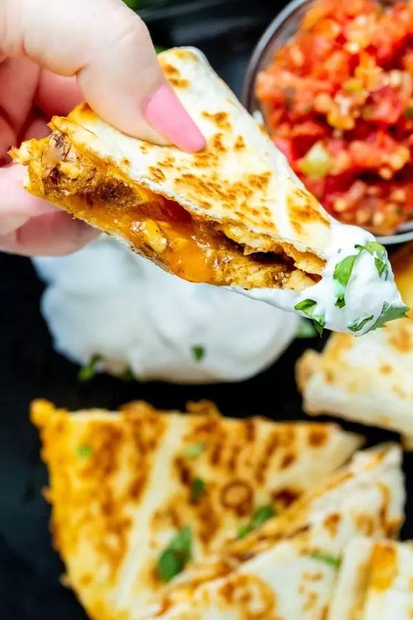 Chicken Quesadillas dipped in sour cream