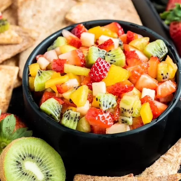 black bowl of Fruit Salsa with Cinnamon Chips