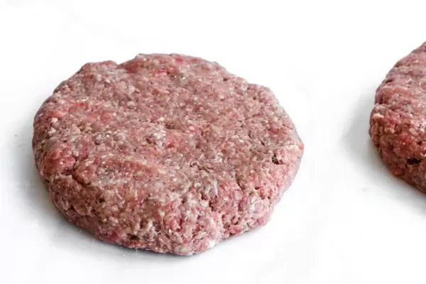 Burger patty made from ground beef and lightly seasoned
