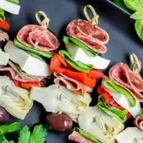 Italian Antipasto skewers on a black platter