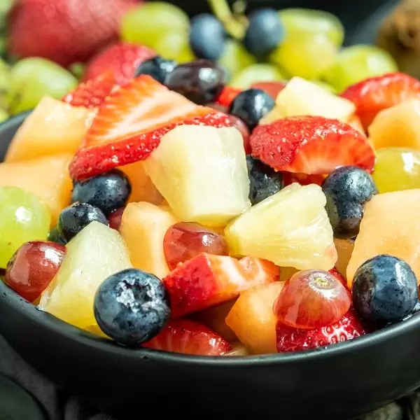 Lemonade Fruit Salad in a black bowl