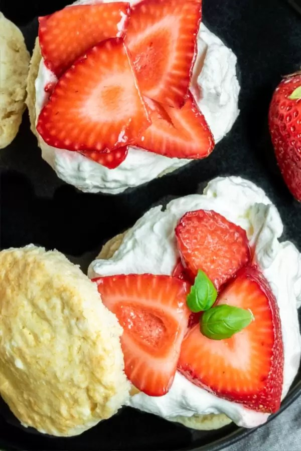 Top down shot of homemade Strawberry shortcake with fresh biscuits, whipped cream and strawberries