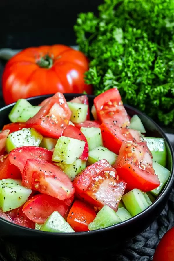 Cucumber and Tomato Salad is an easy side dish perfect for summer partys