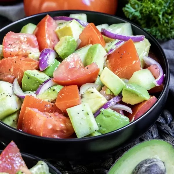 Pinterest image for Cucumber Tomato Avocado Salad with title text