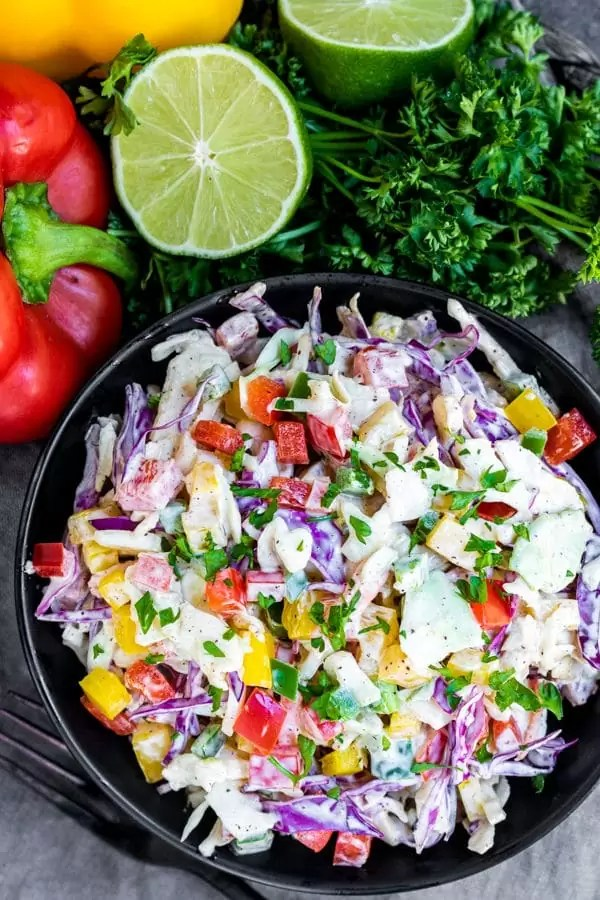 bowl of Spicy Jalapeno Coleslaw with fresh veggies