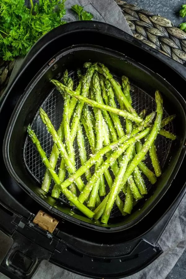 Air Fryer Asparagus in air fryer basket