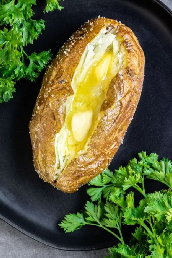 Air Fryer Baked Potato with butter on plate