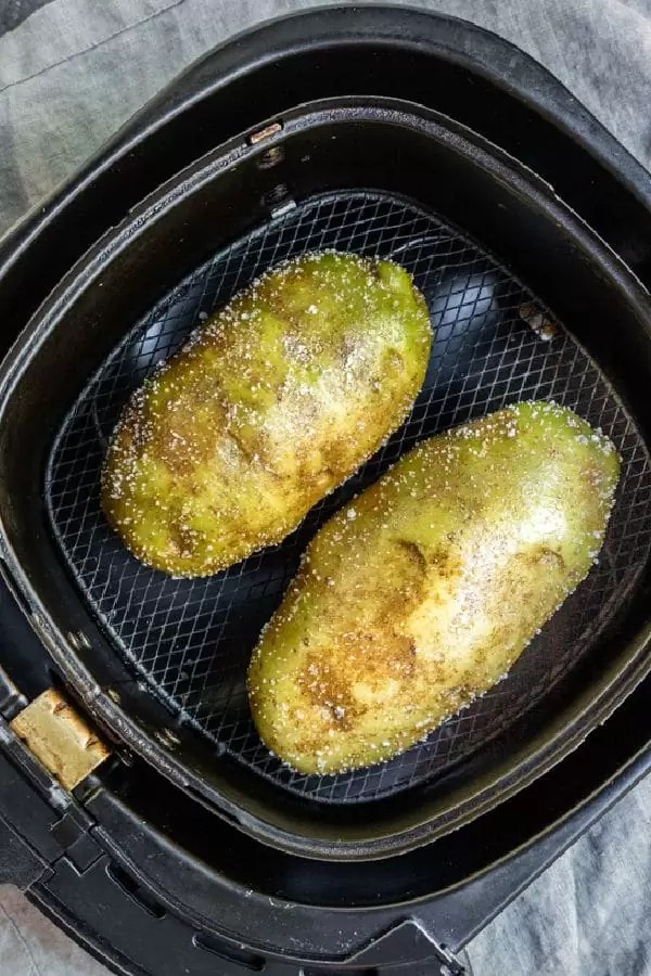 Air Fryer Baked Potato in air fryer basket