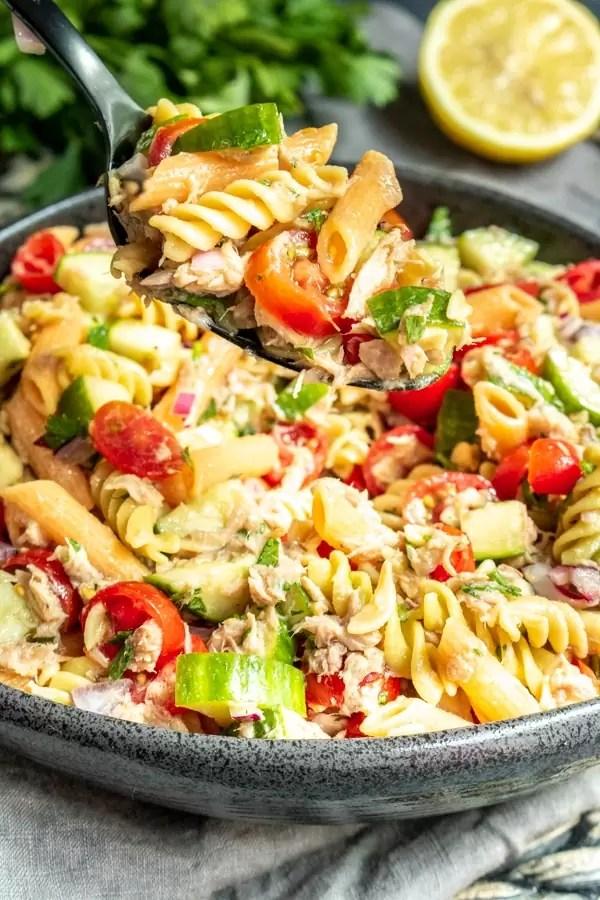 tossing a big bowl of Tuna Pasta Salad