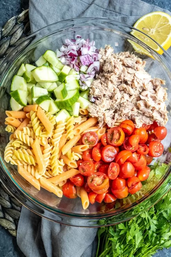 Tuna Pasta Salad ingredients in a glass bowl