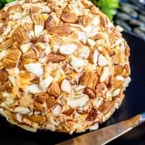 Keto Buffalo Chicken Cheese Ball coated in almonds