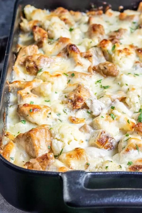 cheesy Keto Chicken Alfredo Casserole in a black dish